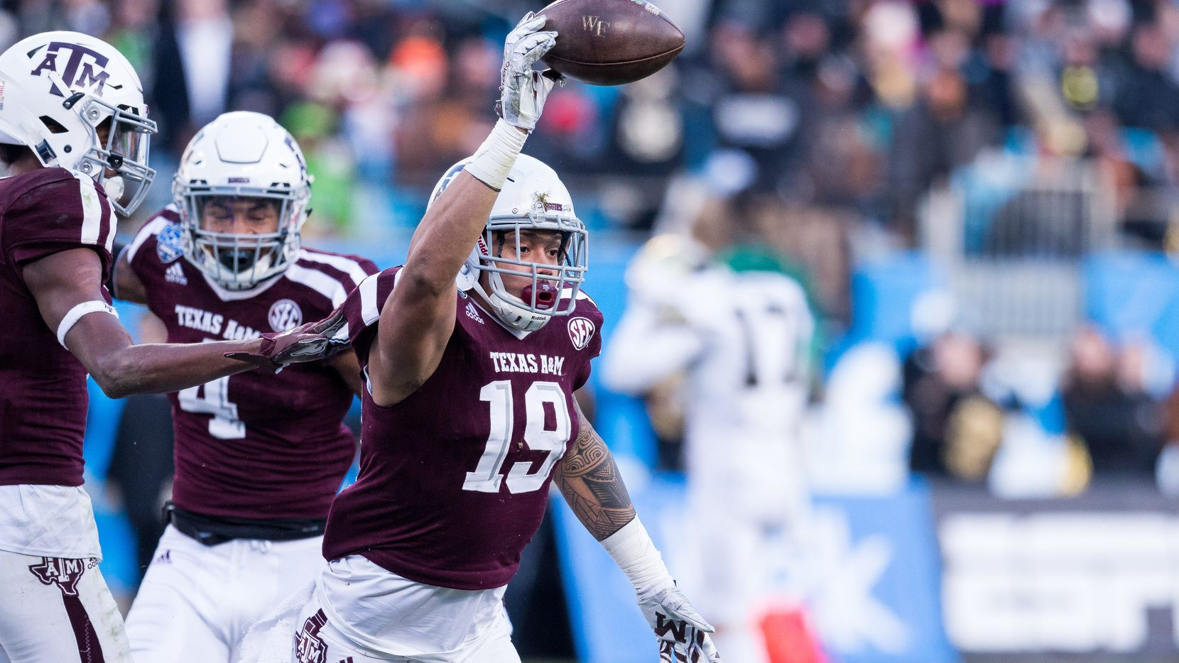 December 29, 2017: Texas A&M linebacker Anthony Hines III (19) celebrates after recovering the fumble in the matchup between Texas A&M and Wake Forest at Bank of America Stadium in Charlotte, NC.