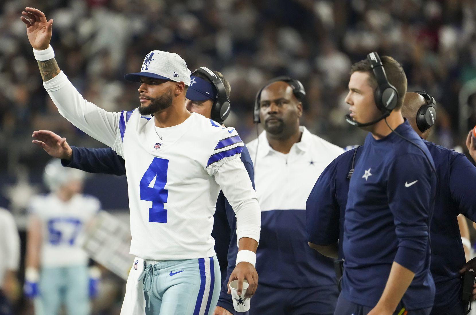 Cowboys quarterback Dak Prescott celebrated a touchdown run by running back Tony Pollard during the first half of Saturday's preseason game against the Houston Texans at AT&T Stadium in Arlington.