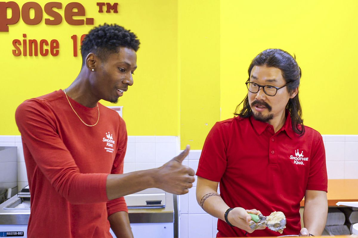 The CEO of Smoothie King, on right, wore a costume, wig and goatee for the filming of 'Undercover Boss.' The show was filmed in four cities, including at a local shop in Addison.