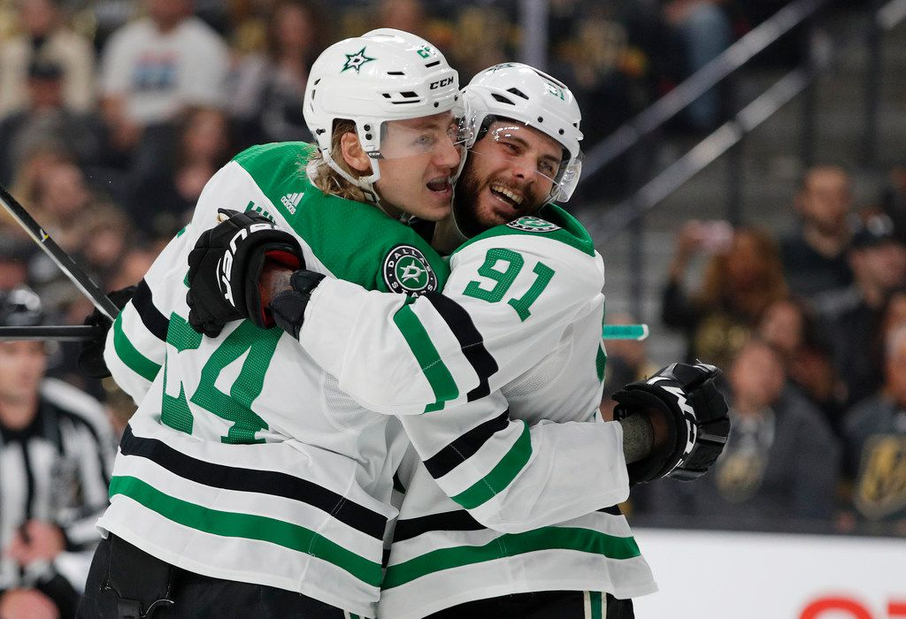 Dallas Stars center Tyler Seguin (91) celebrates after left wing Roope Hintz (24) scored against the Vegas Golden Knights during the first period of an NHL hockey game Tuesday, Feb. 26, 2019, in Las Vegas.
