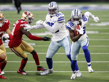 Dallas Cowboys wide receiver CeeDee Lamb (88) picks up an onside kick and races for a fourth quarter touchdown against the San Francisco 49ers at AT&T Stadium in Arlington, Texas, Sunday, December 20, 2020. The Cowboys won, 41-33.