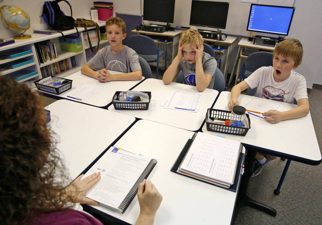 Andrew Dunn, (from left) Cody Williams and William Minich study the alphabet with their teacher Dachia Kearby in the dyslexia center at Texas Scottish Rite Hospital for Children in Dallas on October 26, 2016.  (Nathan Hunsinger/The Dallas Morning News)