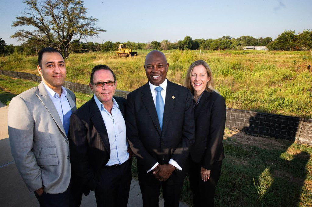 From left: Camden Homes partners Cyrus Zadeh and Simmie Cooper, Dallas City Council member Tennell Atkins and Civitas Capital Group Director of Asset Management Tillie Borchers in front of the lot where Camden Homes, with help from the GrowSouth Fund, will break ground on a single-family home development in southeast Dallas.