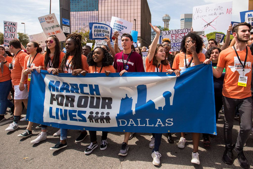 Student organizers lead a march and rally in support of gun safety laws on March 24 in Dallas. The March For Our Lives event was held in conjunction with hundreds of sibling marches across the nation in the wake of the Feb. 14 deadly school shooting in Parkland, Fla. that killed 17 students and staff.