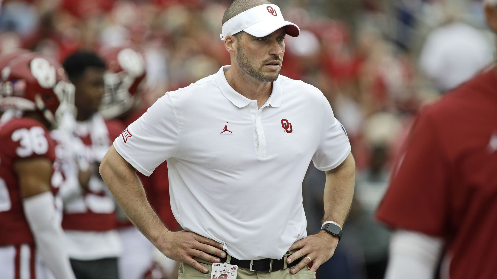 Defensive coordinator Alex Grinch observers warm ups before the game against the Texas Tech Red Raiders at Gaylord Family Oklahoma Memorial Stadium on September 28, 2019 in Norman, Oklahoma. The Sooners defeated the Red Raiders 55-16. (Photo by Brett Deering/Getty Images)