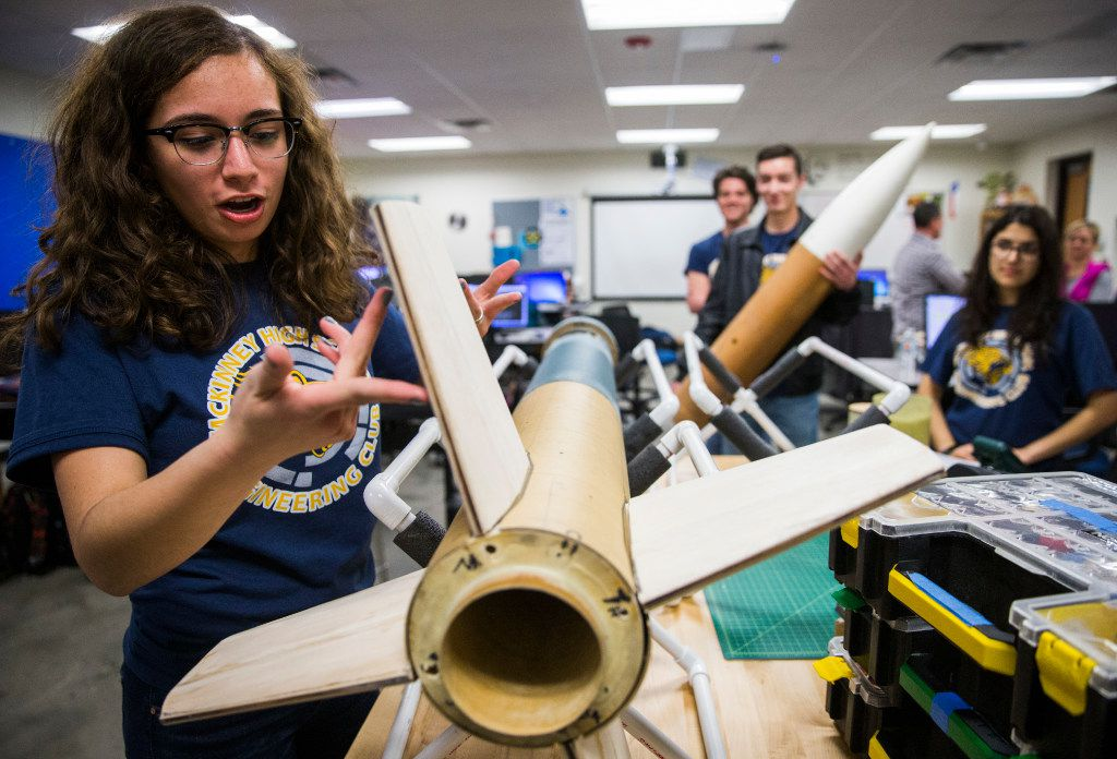 Alex Macias, 16, chief of safety for the McKinney High School Flying Lions Rocketry Club, explains how air flows past the fins on their nearly ten foot long rocket on Tuesday, March 14, 2017 at McKinney High School in McKinney, Texas. The team has been awarded an eight-month unfunded NASA contract to design and build a reusable high-powered rocket and payload that they will launch to an altitude of one mile above ground level. In April, they will join 17 other high school teams at NASA's Marshall Space Flight Center in Huntsville, Alabama. (Ashley Landis/The Dallas Morning News)
