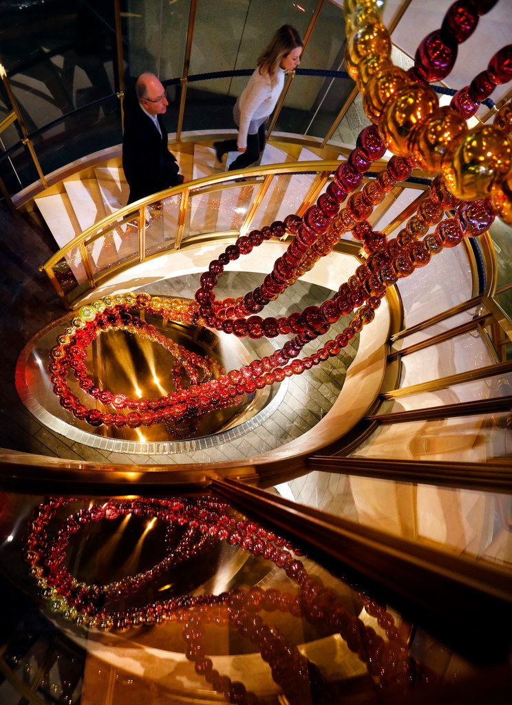 The Necklace of Dreams sculpture by Jean-Michel Othoniel lines the circular staircase at the French restaurant Bullion in downtown Dallas.