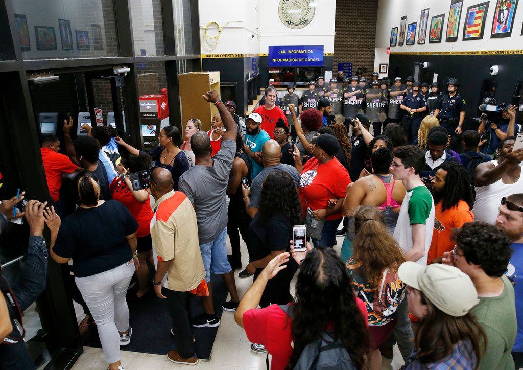 Protesters express their anger Wednesday after Amber Guyger was sentenced to 10 years in prison for Botham Jean's murder. Many said the term was too short, given that the prison system has black inmates who are serving more time for lesser crimes.