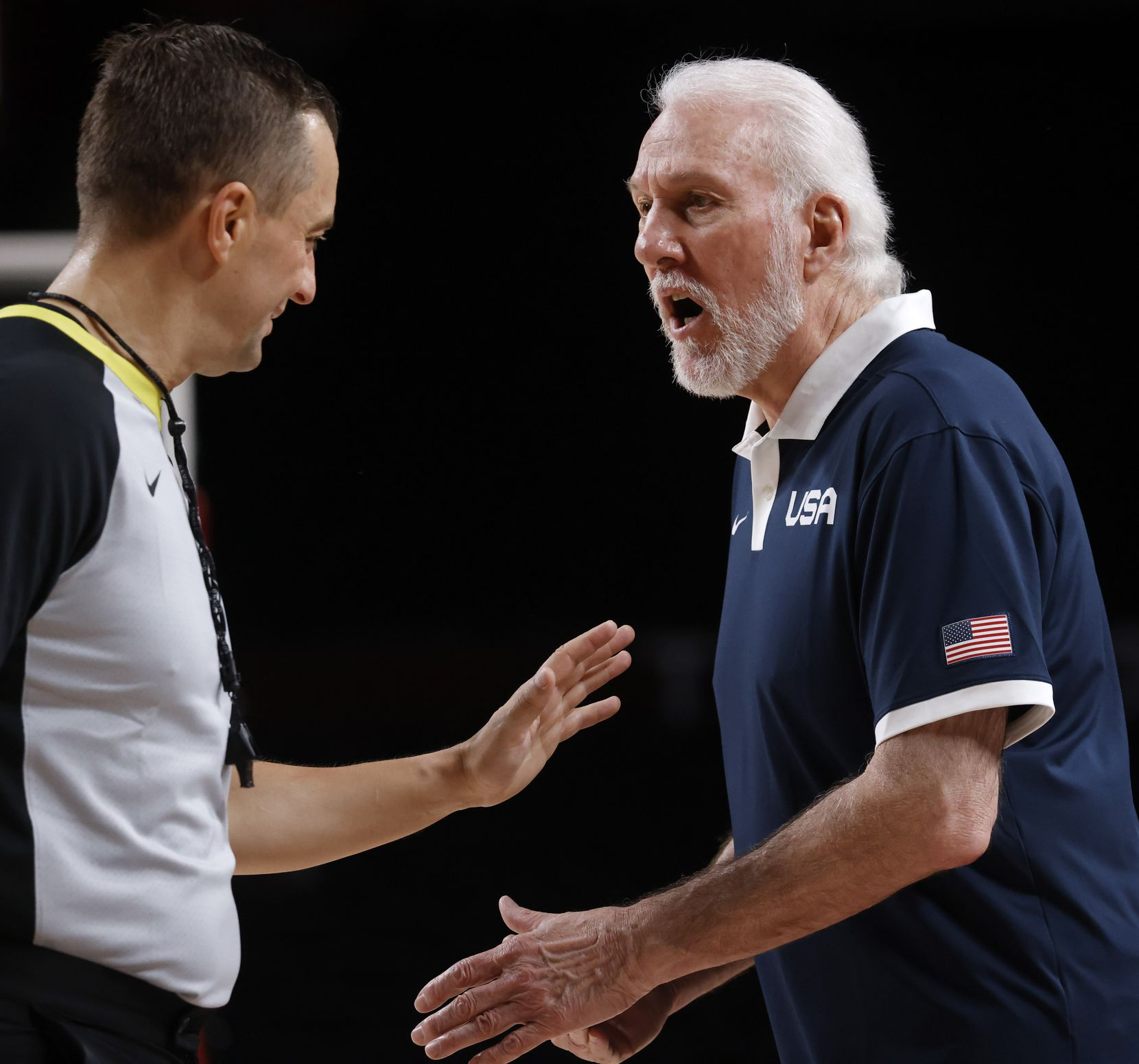 USA's head coach Gregg Popovich talks to a referee about a call in a game against Australia during the first half of a men's basketball semifinal at the postponed 2020 Tokyo Olympics at Saitama Super Arena, on Thursday, August 5, 2021, in Saitama, Japan. USA defeated Australia 97-78 to advance to the gold medal game. (Vernon Bryant/The Dallas Morning News)