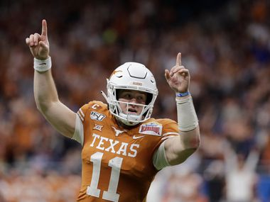 Texas quarterback Sam Ehlinger (11) celebrates a touchdown against Utah during the first half of the Alamo Bowl NCAA college football game in San Antonio, Tuesday, Dec. 31, 2019.