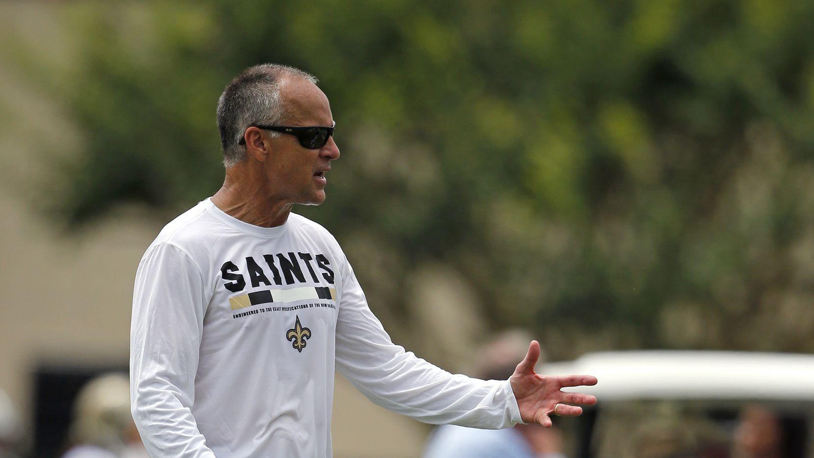 New Orleans Saints linebacker coach Mike Nolan runs drills during NFL football practice in Metairie, La., Tuesday, June 13, 2017. (AP Photo/Gerald Herbert)