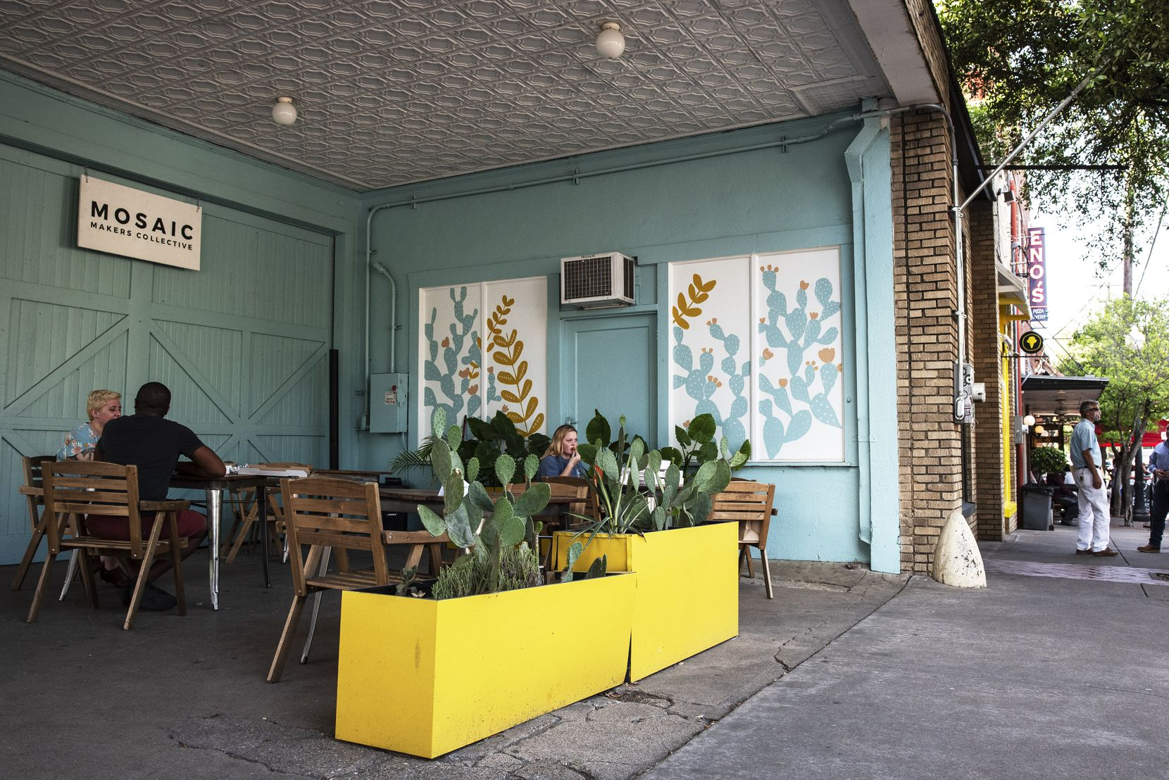 The current patio seating area for Eno's Pizza Tavern, outside of Mosaic Makers Collective as Mosaic remains closed for business, Friday, May 15, 2020 in Dallas. Shane Spillers, co-owner of the pizza tavern, said he plans to take the seating out onto the right of way as a sidewalk extension once Mosaic reopens.