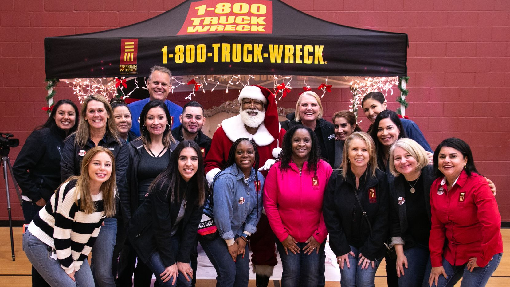 Dallas and Fort Worth office team members from Witherite Law Group and its founding partner, Amy Witherite (next to Santa), posed for a photo in November as they distributed over 400 jackets to Fort Worth residents at the firm's fourth annual jacket gifting event. The event included free books, jackets, photos with Santa, a bounce house, photo booth and lunch from Campisi s for all attendees.