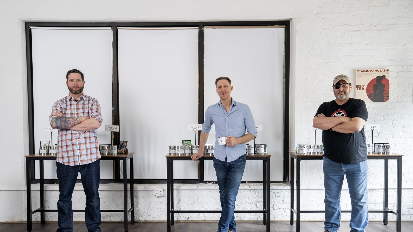 TK Kamauf, Brandon Friedman and Lance John, left to right, pose for portraits inside their new Rakkasan Tea brick-and-mortar store near Hall Street and Ross Avenue in Dallas.