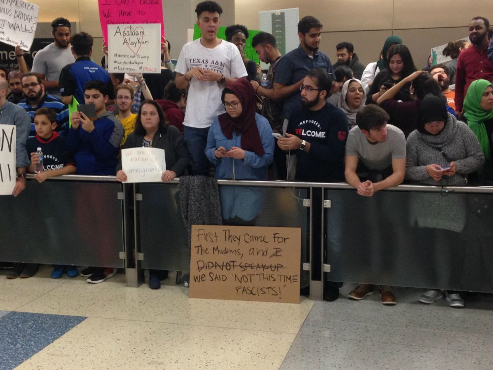 Hundreds protested in Terminal D at DFW International Airport on Saturday night. (Robert Wilonsky/Staff)