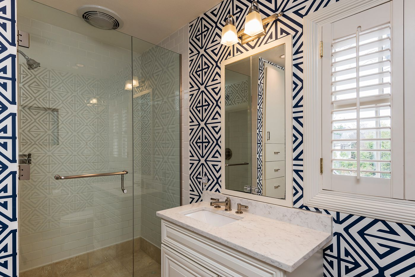 Bathroom with printed accents at 5845 Lupton Drive.