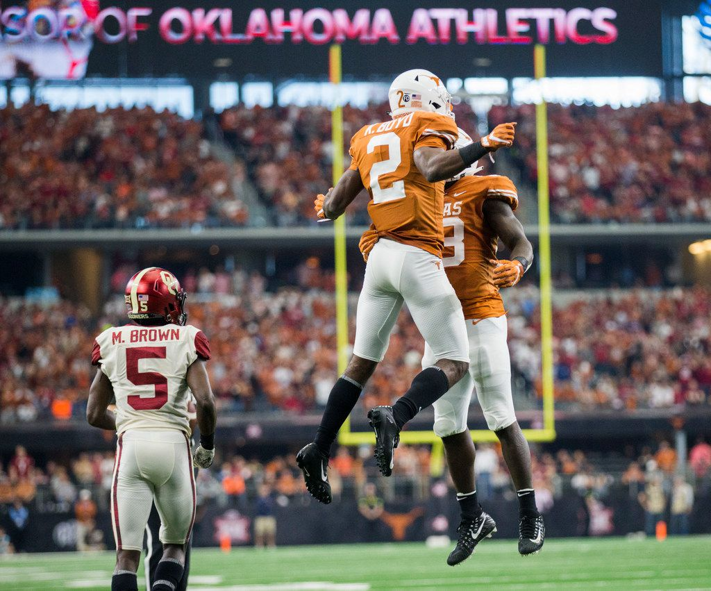 Texas Longhorns defensive back Kris Boyd (2) celebrates with linebacker Gary Johnson (33) after preventing a catch in the end zone by Oklahoma Sooners wide receiver Marquise Brown (5) during the second quarter of the Big 12 Championship football game between the Texas Longhorns and the Oklahoma Sooners on Saturday, December 1, 2018 at AT&T Stadium in Arlington, Texas. (Ashley Landis/The Dallas Morning News)