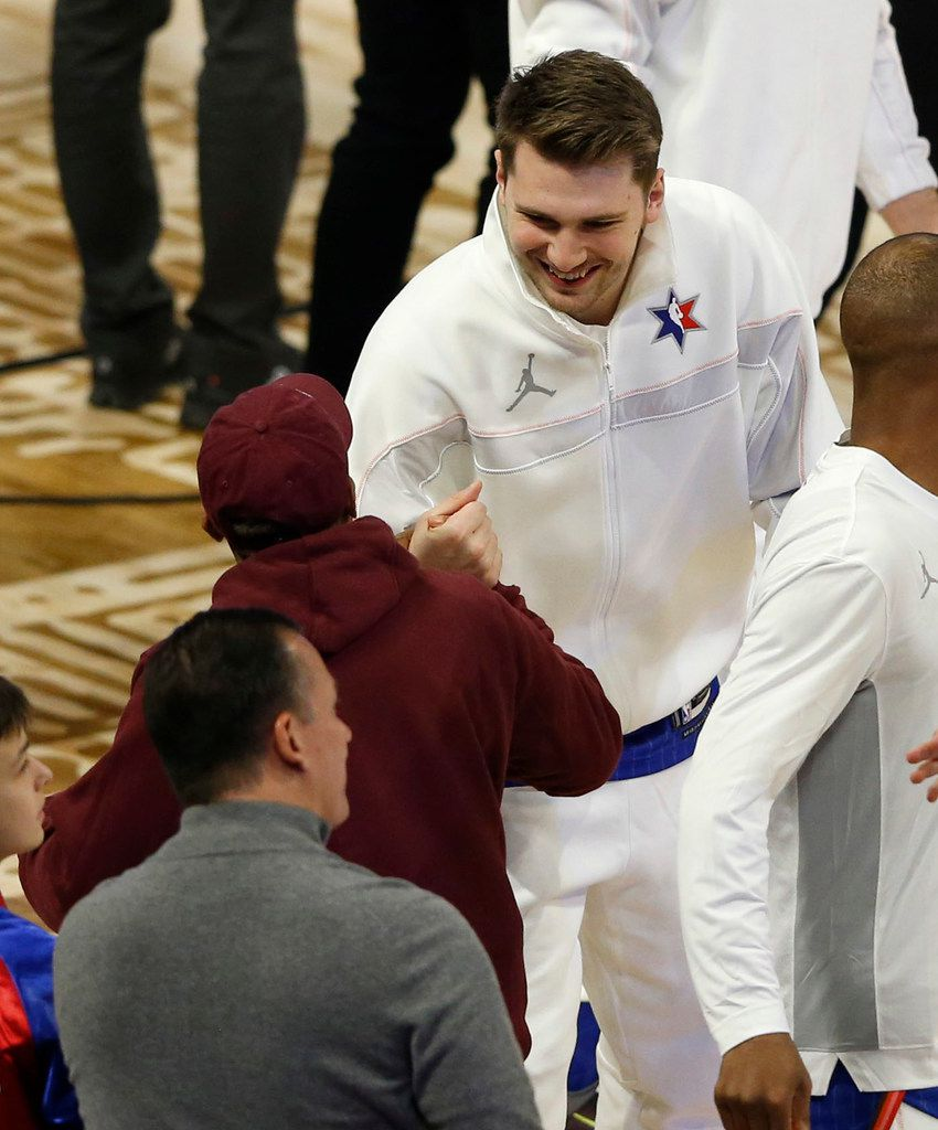Team LeBron's Luka Doncic of the Dallas Mavericks meets Spike Lee before a game against Team Giannis in the NBA All-Star 2020 game at United Center in Chicago on Sunday, February 16, 2020. (Vernon Bryant/The Dallas Morning News)