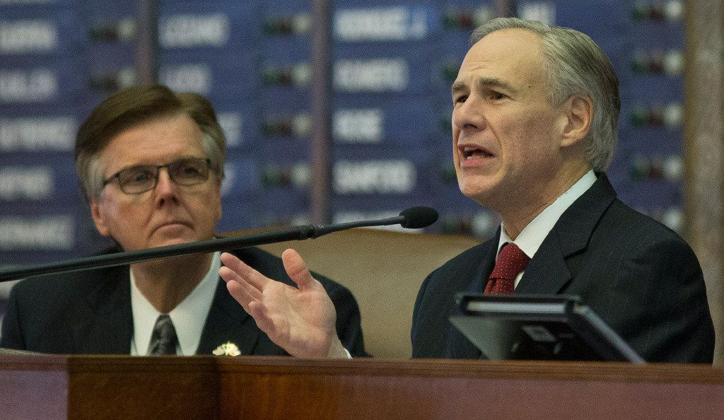 Texas Gov. Greg Abbott, right, delivers his State of the State address to a joint session of the House and Senate, Tuesday, Jan. 31, 2017, at the Texas Capitol in Austin, Texas. Texas Lt. Gov. Dan Patrick at left. (AP Photo/Stephen Spillman)