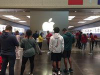 Shoppers wait in line to get into the NorthPark Center Apple store in Dallas on Black Friday.