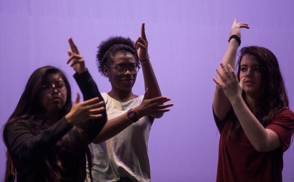From left: Regina Juarez, Trinity Gordon and Michaela Langford, all 17, walk through a scene of Shots Fired during rehearsals at Eastfield College in Mesquite. The show opens for its second run on July 7, the first anniversary of the Dallas police ambush.