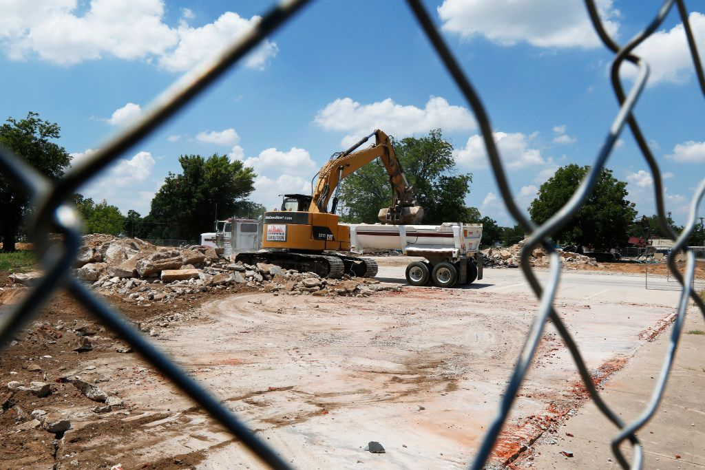 Demolition of several buildings continues at the River East project in the 2900 block of Race Street in Fort Worth, a site which is part of the EB-5 immigrant investor visa. In that program, foreigners invest money in American enterprises in exchange for getting on the fast track to receive a green card.