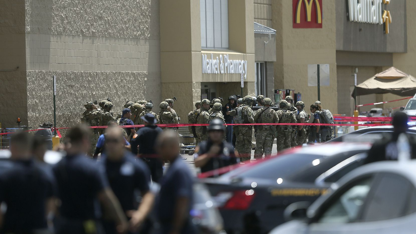 Law enforcement agencies respond to the mass shooting at a Walmart in El Paso on Aug. 3, 2019. Patrick Crusius was indicted for the killing of 22 people in the mass shooting in state court and he now faces federal hate crime charges, too.