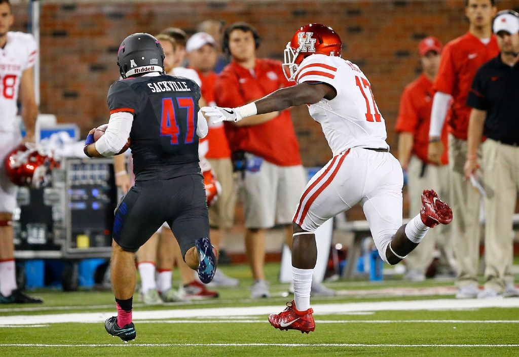 Southern Methodist Mustangs punter Jamie Sackville (47) takes off running on a fake punt to pick up the first down against Houston Cougars defensive end Chauntez Jackson (17) in the third quarter at Gerald J. Ford Stadium in University Park, Texas, Saturday, October 22, 2016. SMU upset Houston, 38-16.  (Tom Fox/The Dallas Morning News)