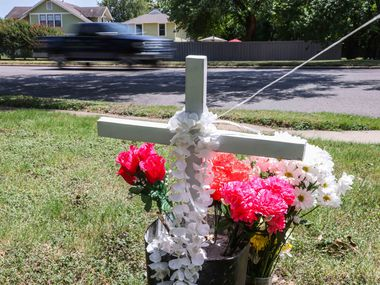 A makeshift memorial honoring Armando Leija near the intersection of West Jefferson Boulevard and Winnetka Avenue in Dallas on Saturday, July 24, 2021. Leija was on a lawnmower cutting grass when he was hit by a car that lost control and went off the road. (Lola Gomez/The Dallas Morning News)