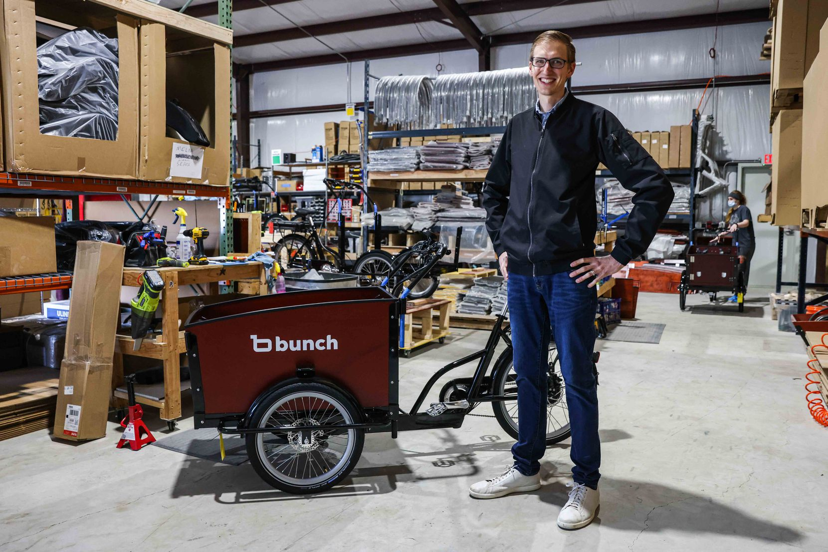 Aaron Powell poses next to one of his bikes at Bunch Bikes in Denton on Wednesday, March 24, 2021. (Lola Gomez/The Dallas Morning News)