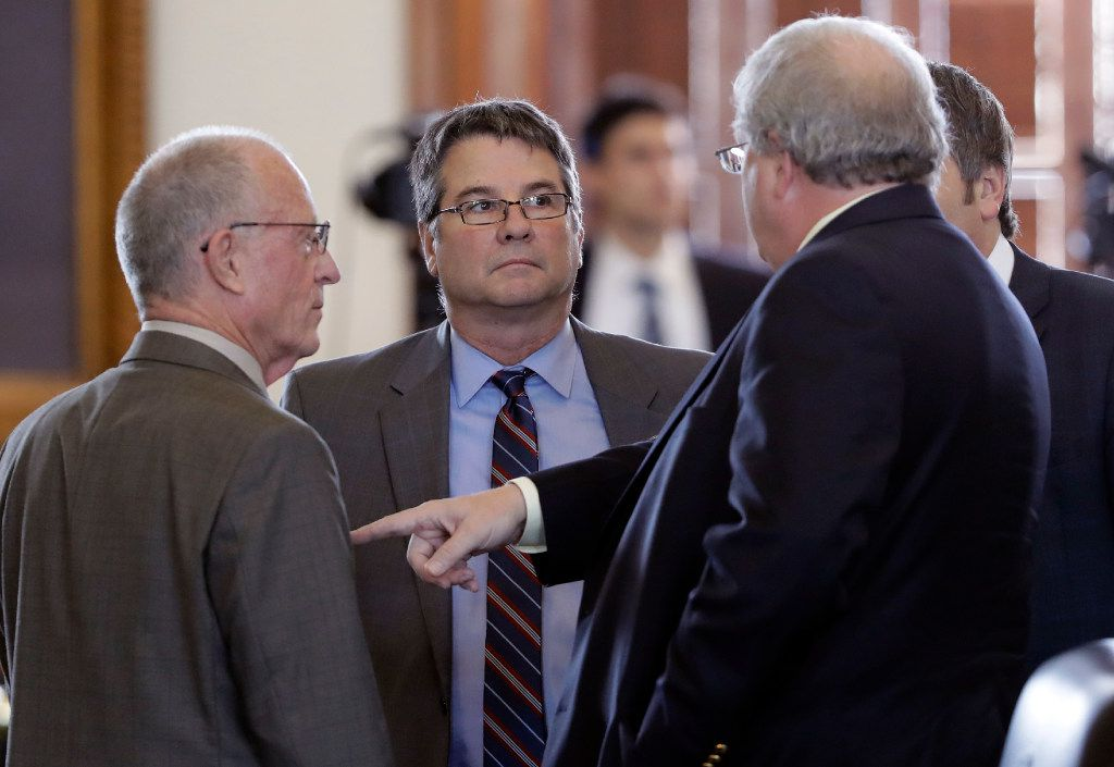 "Sen. Charles Perry (center), R-Lubbock, talked with fellow senators before a vote on the sanctuary cities bill in February 2017. On April 2, 2019, the Texas Senate debated Perry's Senate Bill 17, which would bar state occupational licensing boards from passing rules limiting ""an applicant's ability to maintain or renew a license based on a sincerely held religious belief."""