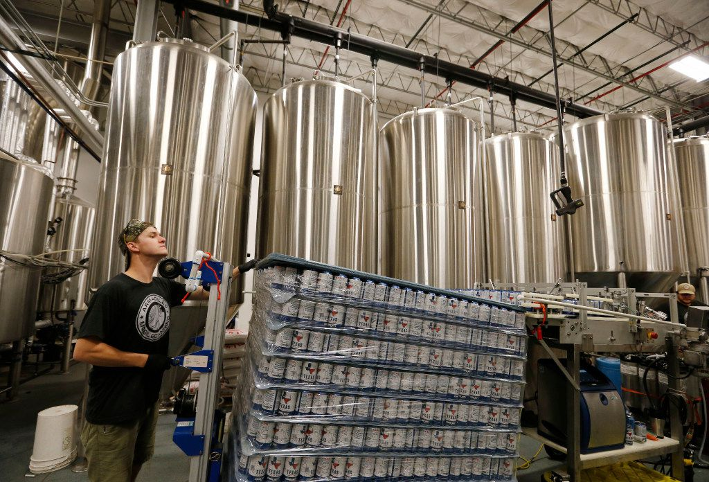 Micah Smits of Dallas readies the next batch of cans for canning Texas Helles at Community Beer Co. in Dallas on Oct. 17, 2016. (Vernon Bryant/The Dallas Morning News)