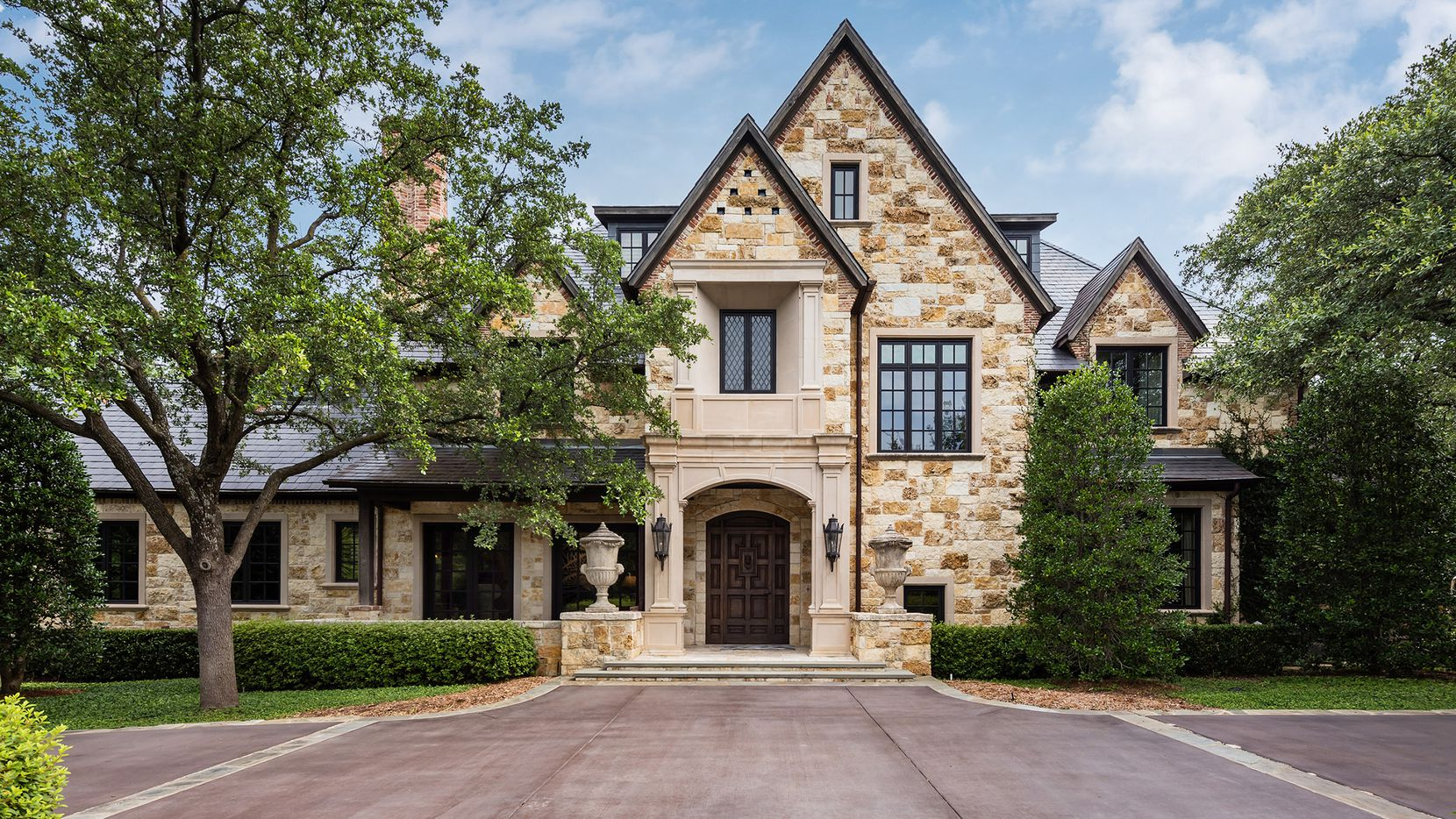 The 2-acre estate at 5031 Deloache Ave. in Preston Hollow features a media room, sport court, putting green and pool.