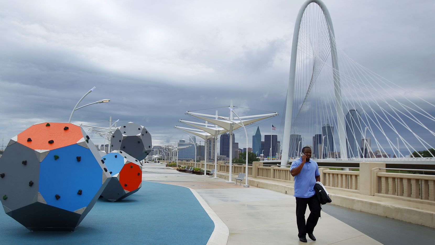The Continental Avenue Bridge project manager, Vincent Lewis, a senior engineer with the City of Dallas, walked the new pedestrian area Thursday morning despite the rain.  The bridge that connects to West Dallas and Trinity Grove is one of the most recent improvements to the Trinity River Corridor in Dallas.