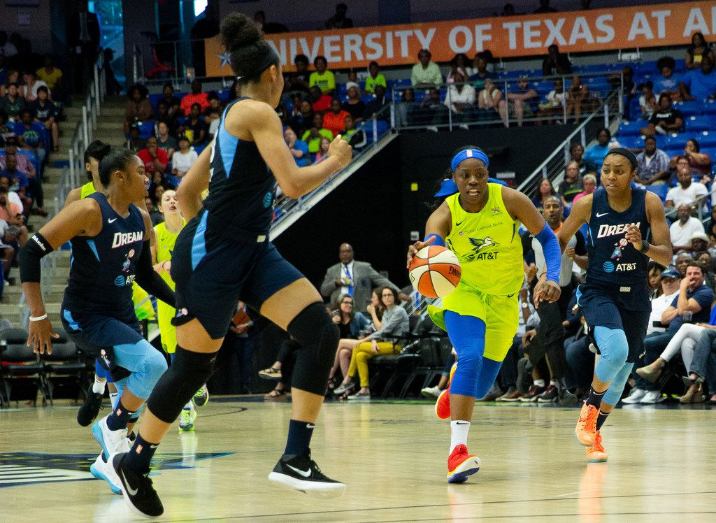 Dallas Wings guard Arike Ogunbowale (left) drives the ball past Atlanta Dream guard Renee Montgomery (right) during the second quarter of a WNBA game between the Dallas Wings and the Atlanta Dream on Saturday, June 15, 2019 at College Park Center on the UTA campus in Arlington.  (Lynda M. Gonzalez/The Dallas Morning News)