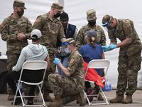 U.S. Army personnel conduct COVID-19 vaccinations at the Dallas site at Fair Park, on Friday, March 05, 2021.