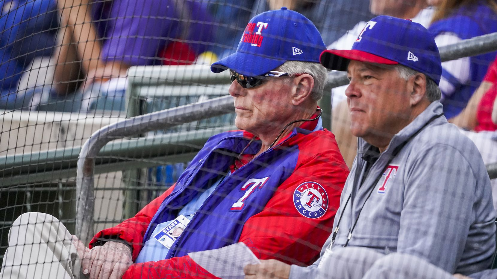 Texas Rangers co-chairman and managing partner Ray C. Davis (left) and chairman, ownership committee and chief operating officer Neil Leibman watch during the third inning of a spring training game against the Chicago Cubs at Surprise Stadium on Thursday, Feb. 27, 2020, in Surprise, Ariz.