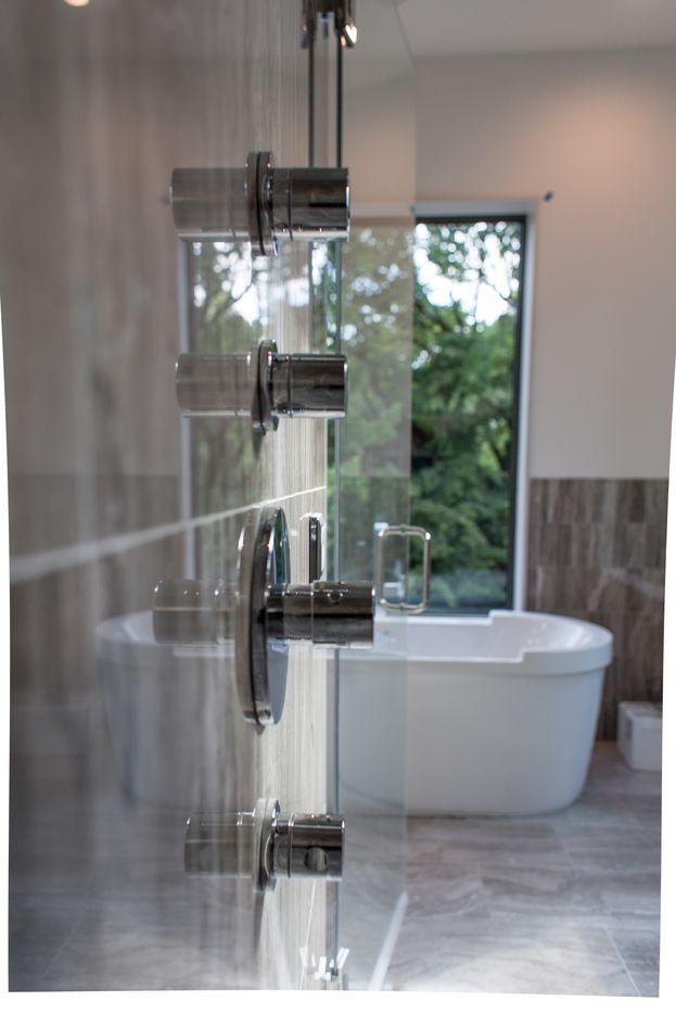 Richard Miller Custom Homes house near White Rock Lake has a polished stone bathroom.