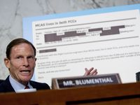Rep. Richard Blumenthal, D-Conn., displays an email exchange behind him as he questions Boeing Company President and Chief Executive Officer Dennis Muilenburg as he testifies before a Senate Committee on Commerce, Science, and Transportation hearing on 'Aviation Safety and the Future of Boeing's 737 MAX' on Capitol Hill in Washington, Tuesday, Oct. 29, 2019.