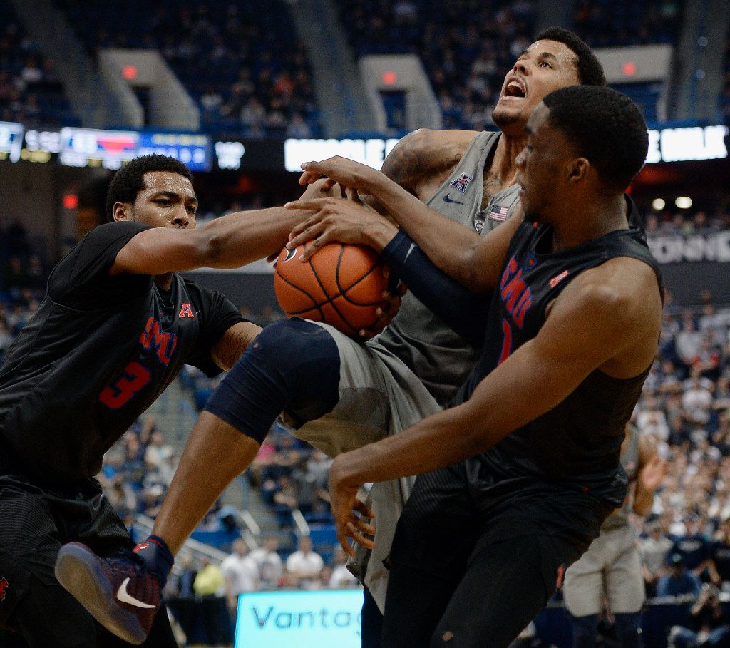 SMU's Sterling Brown pulls the ball from Connecticut's Vance Jackson, center, as SMU's Shake Milton, right, defends, in the second half of an NCAA college basketball game, Saturday, Feb. 25, 2017, in Hartford, Conn. (AP Photo/Jessica Hill)