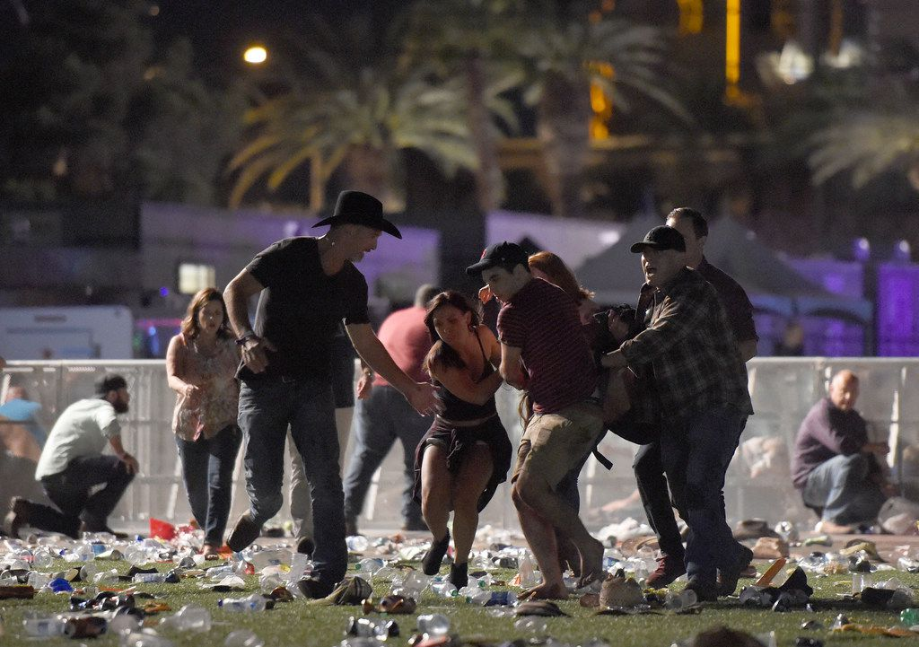 People carry a victim at the Route 91 Harvest country music festival after gunfire was heard in Las Vegas.