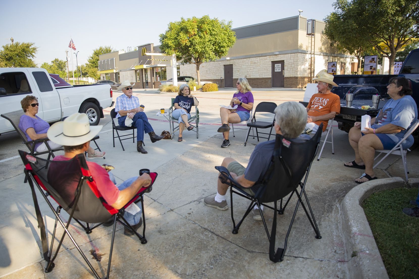 A group of retired friends eat and socialize at the McDonald's parking lot on Aug. 22 in Keller.