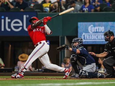 Texas Rangers Adolis Garcia (53) hits the ball against Seattle Mariners during fourth inning at Globe Life Field in Arlington, Texas, Friday, July 30, 2021. (Lola Gomez/The Dallas Morning News)