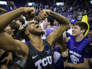 TCU Horned Frogs guard PJ Fuller (4) celebrates after fans rush the court because of a 75-72 win over Baylor on Saturday, February 29, 2020 at Ed & Rae Schollmaier Arena on the TCU campus in Fort Worth.