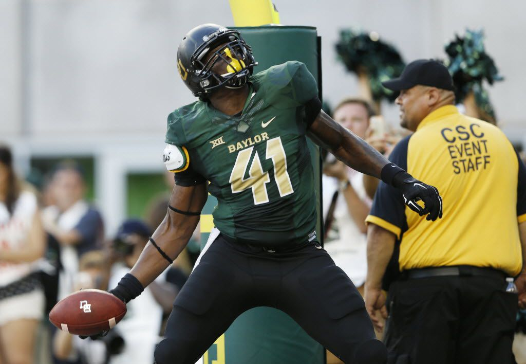 Former Baylor Bears tight end Tre'Von Armstead (41) tosses the ball to the stands after scoring a touchdown during the first half of play in the inaugural game between Baylor University and Southern Methodist University at McLane Stadium in Waco on Sunday, August 31, 2014. (Vernon Bryant/The Dallas Morning News)
