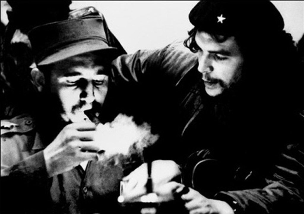 """(FILES) This file photo taken in the 60s shows then-Cuban Prime Minister Fidel Castro (L) lighting a cigar while listening to Argentine Ernesto Che Guevara. Cuban revolutionary icon Fidel Castro died late on Nov. 25, 2016, in Havana, his brother, President Raul Castro, announced on national television. / AFP PHOTO / CUBADEBATE / ROBERTO SALAS / RESTRICTED TO EDITORIAL USE - MANDATORY CREDIT """"AFP PHOTO/ROBERTO SALAS/CUBADEBATE"""" - NO MARKETING NO ADVERTISING CAMPAIGNS - DISTRIBUTED AS A SERVICE TO CLIENTS  ROBERTO SALAS/AFP/Getty Images"""