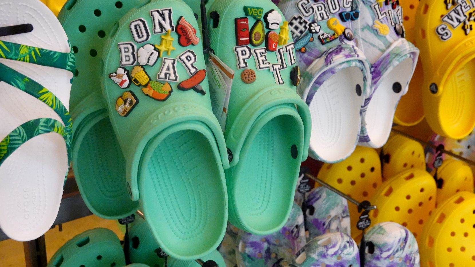 Crocs  are displayed at one of its own retail stores. Last week, Crocs Inc. reported second-quarter net income of $319 million, topping Wall Street expectations.