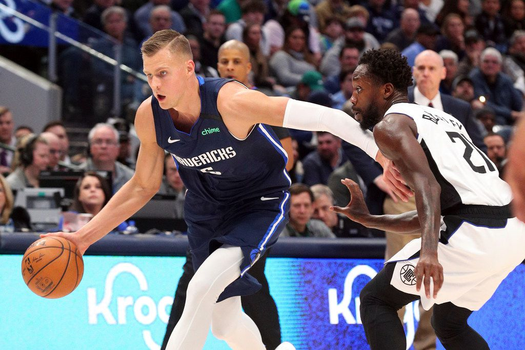Dallas Mavericks forward Kristaps Porzingis (6) drives the ball against Los Angeles Clippers guard Patrick Beverley (21) during the first half of an NBA basketball game Tuesday, Jan. 21, 2020 in Dallas.