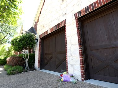 Flowers were left at the home on Nueces Drive in Allen after the slayings.