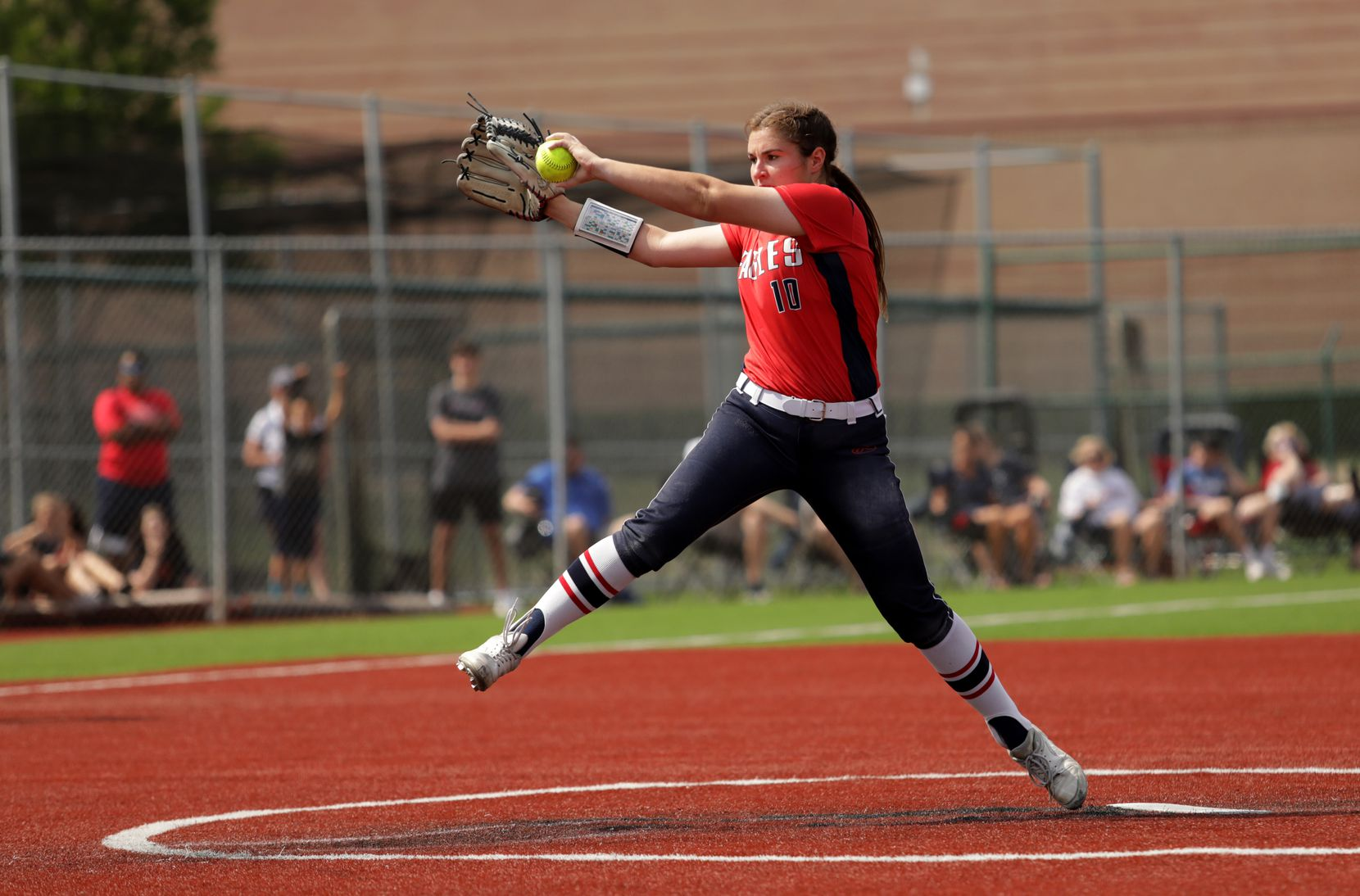 Allen High School player #10, Alexis Telford, pitches against Flower Mound High School during a softball game at Allen High School in Allen, TX, on May 15, 2021. (Jason Janik/Special Contributor)